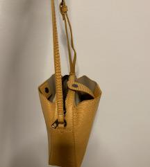 Reserved mala žuta torbica
