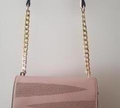 Roza torbica sa zlatnim dijelom remena