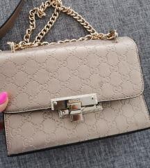 Zlatna torbica like Gucci