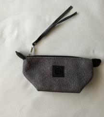 Siva kozmetička torbica