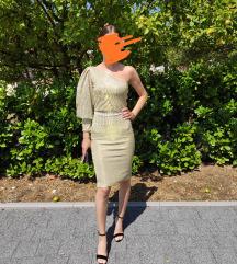 Zlatna haljina na jedno rame