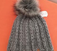 Nova zimska kapa sa etiketom