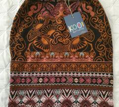 Nova KOOI pletena suknja vel. L
