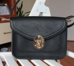 Mala crna torbica, NOVO