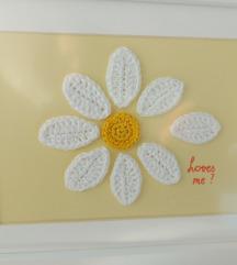 Isheklani cvijet u okviru