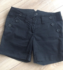 H&M crne hlačice s gumbima
