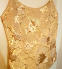 Zlatni komplet topic i duga suknja