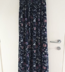 Duga cvjetna haljina .