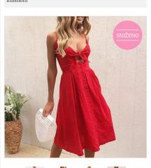saptac cipelama crvena haljina