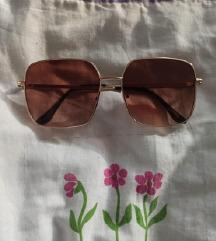 Smeđe kockaste sunčane naočale