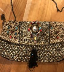 Zlatna torbica s ukrasima