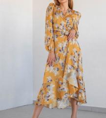 Lukabu midi žuta haljina dugih rukava