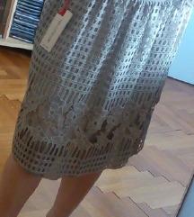 Čipkasta bež suknja