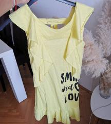 Žuta haljina golih ledja
