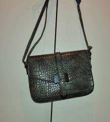 torbica s uzorkom kože