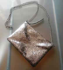 H&M srebrna torbica sa šljokicama