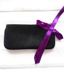 Crna torbica za oko zapešća