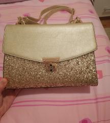 Zlatna torbica sa zlatnim šljokicama