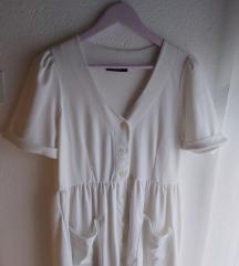 Nenošena bijela haljina