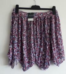 Sarena suknja s etiketom L velicina