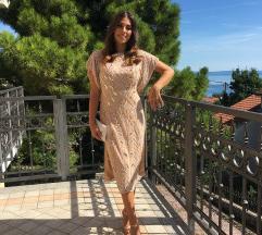 Bogata haljina asos od perla i cirkona