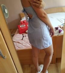 Mini haljinica otvorenih leđa