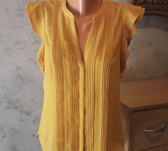 Žuta bluza sa faldama