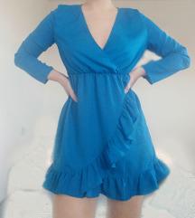 Plava haljina s volanima