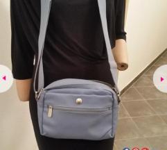 Samsonita plava torbica
