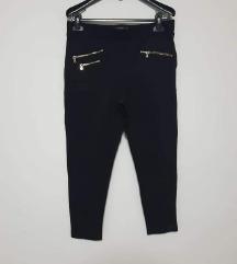 Zara crne tajice/hlače sa srebrnim zipovima