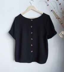 Crna bluza s kopčanjem na leđima