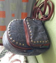 Mini ruksak-novi s etiketom