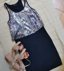 Mala crna haljina od makoa sa sljokicama