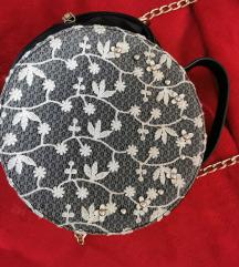 Okrugla torbica s cvjetnim uzorkom