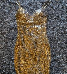 Zlatna šljokičasta haljina