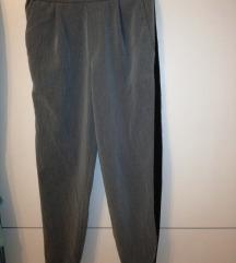 Moderne sive hlače s crtom