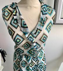 Prodajem tirkizno bijelu Marella haljinu