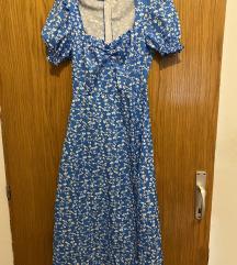 Plava haljina ispod koljena s prorezom