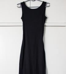 Duga crna haljina, pt. uključena