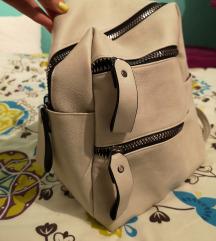 Prljavo bijeli ruksak