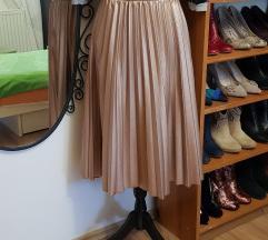 Plisirana kožna suknja u rose gold boji