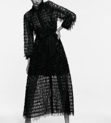 Duga sljokicava haljina