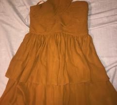 Narančasta haljina na jedno rame