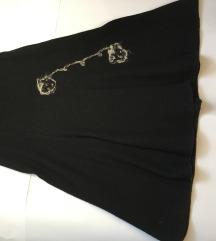 Debela vunena suknja s aplikacijom