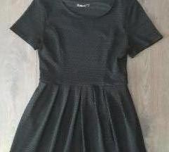 Nova crna haljinica