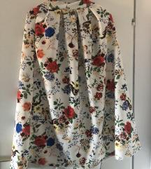 Dugačka bijela suknja s cvjetovima