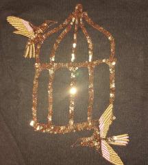Pulover sa zlatnim detaljima S