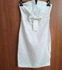 Prekrasna ivory haljina sa mašnom veličina S