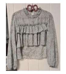 Zara bluza s volanima