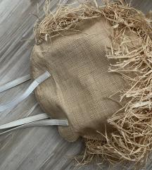 Okrugla slamasta pletena torba za plazu
